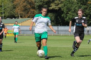 Scorer Megan Fox on the run for Chi against Cambridge / Picture by Sheena Booker