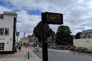 An existing passenger information screen in West Street, Chichester, opposite the cathedral