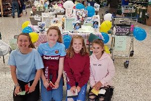 Kayleigh Holman and three other former William Alvey girls, Eden, Libby and Ruby doing their fund raiser. EMN-190827-140536001