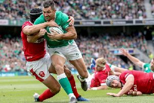Ireland fullback Rob Kearney goes over for the opening try against Wales at the Aviva Stadium