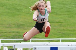 Fleur Hollyer flies over the hurdles at Sutton / Picture by Lee Hollyer