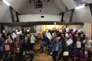 Residents at a public meeting in Chidham calling for a reduction in the number of homes to be built in the Chichester district. 30-09-19.