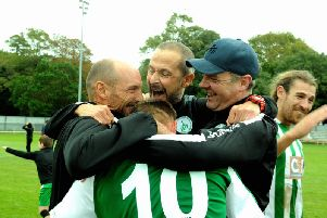 Boss Miles Rutherford, coach Darin Killpartrick and assistant boss Graeme Gee celebrate with scorer Lloyd Rowlatt / Picture by Kate Shemilt