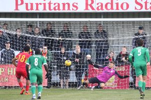 Banbury United's Jaanai Gordon slams home his penalty to equalise against Biggleswade Town. Photo: Steve Prouse