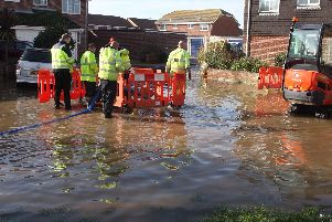 A burst water pipe has caused 'major flooding' inCoppice Lane. Photo: Derek Martin Photography