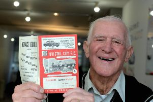 Nigel Hillier with the programme from the Bristol City tie / Picture by Kate Shemilt