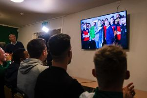 Chichester City players watch the first-round draw in the Oaklands Park clubhouse / Picture: Daniel Harker