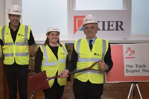 Construction of a new, creative digital hub, called The Track, has started in Bognor Regis. From right to left, county council cabinet member Bob Lanzer, Aecom project manager Bronwen Byng and Kier site manager Ty Donat SUS-191111-113713001