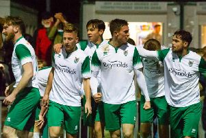 Dan Smith's late winner is celebrated by Bognor's players / Picture by Tommy McMillan
