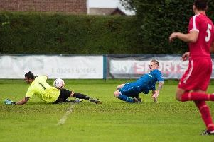 Max Davies - pictured scoring against Shoreham - scored all four in Selsey's last-gasp 4-3 win at Storrington / Picture by Chris Hatton