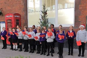Southway Primary School pupils singing loud for all to hear at Bognor Regis railway station