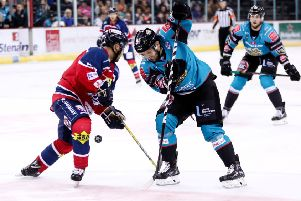 Belfast Giants David Rutherford with Dundee Stars Drydn Dow