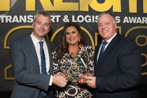 Maire Claire with her award presented by Volvo Trucks UK & Ireland Network Truck Sales Director, Joe Roddy (right) and BBC sports presenter Joel Taggart who compered the ceremony.