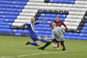 Moulton Harrox (blue) in action in last season's Senior Cup Final at the ABAX Stadium.