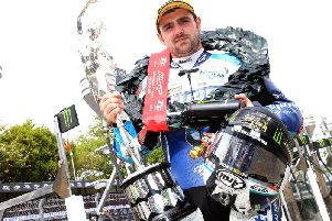 Michael Dunlop with the Superbike trophy at last year's Isle of Man TT.