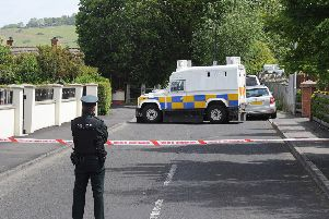 PSNI officers pictured at the scene iin Eglinton yesterday after the home of PSNI officers was targeted when a bomb was left under a car. DER2415MC056