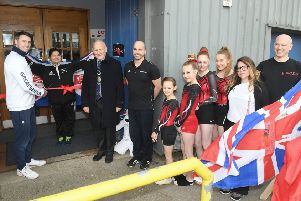 Sleaford Elite Gymnastics Club official opening of new premises with olympic gymnast Kristian Thomas and Spanish olympic trampolinist Humberto Hernandez. Kristian Thomas cutting the ribbon. EMN-190804-095724001
