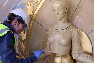 Sarah Mayfield carries out restoration work on the Ceres statue. Photograph: Brighton Dome