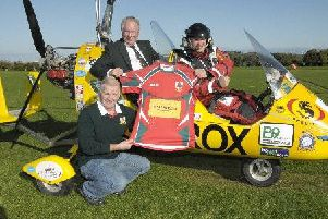 Norman Surplus  pictured with Larne RFC President Philip McMurtry and Paul Johnston following a previous flight.