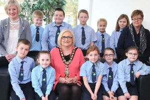 The Mayor of Causeway Coast and Glens Borough Council Councillor Brenda Chivers pictured with pupils from Kilrea Primary School;  ECO Schools co-ordinator Claire Anderson and Principal Karen Stinston at a civic reception in Cloonavin. ivic reception for Kilrea Primary School to mark Green Flag success. Kilrea PS became the first school in Northern Ireland to win ten Green Flags through the Eco-Schools initiative.