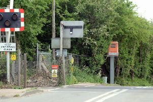 The Red Light Safety Equipment camera by the level crossing