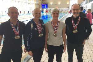 Hemel Hempstead Swimming Club medal winners poolside at the Norfolk Masters Long Course Open held at Norwich University earlier this month.