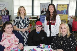 Elaine MacAuley, Inclusive Learning lecturer at Northern Regional College, and Kim Anderson, Project Coordinator from WE CAN Training and Employment, (standing) are pictured with Transition2Work student Barry Anderson, his sister Shauna and Marion Walker, Services Manager from Cedar (all seated). Barry has completed successful work placements with Can Can Bazaar in Ballymoney, part of Compass Advocacy Network Social Enterprise.