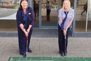 Judith Ball and Lynn Mackey, Store Directors at Coleraine Specsavers getting into the swing of things ahead of The 148th Open at nearby Royal Portrush