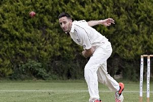 Chris Ringham bowling for March Town against Thriplow. Photo: Pat Ringham.