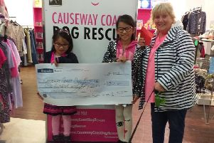 Yum Yum with her sister Yi Jean who raised �155 towards a heart operation for Susie. Yi Jean presented a cheque at the charity's shop in Coleraine to Chairman Maggie Dimsdale-Bobby with one of the rescue dogs Harry