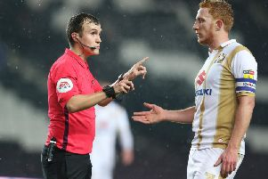 Referee Antony Coggins with Dean Lewington