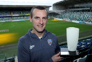 Coleraine manager Oran Kearney with the Belleek trophy