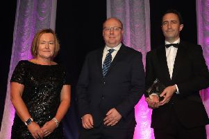 Peter McVerry, U105 (category sponsor) presents the Exporter of the Year Award to Helen Boyd and Mark McQuillan of Nicobrand