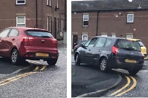 Cars parked on double yellow lines