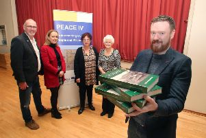 Representatives from Carey Historical Society, Kevin McGowan and Aidan McMichael, with Councillor Cara McShane, Causeway Coast and Glens Borough Council's Museum Services Development Manager Helen Perry and Vice Chair Peace IV Partnership Patricia Crossley pictured at the recent launch of the new book, 'Placenames and Fieldnames of Culfeightrin'
