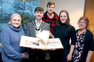 The Mayor of Causeway Coast and Glens Borough Council Councillor Sean Bateson recently received the illuminated address book at an event held in Cloonavin. Included in the picture are Sue McLaughlin, Connie Kelly and Causeway Coast and Glens Borough Council's Museum Services Development Manager Helen Perry. The book is now set to go on display in Coleraine Museum