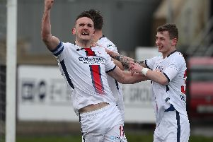 Coleraine captain Stephen O'Donnell celebrates scoring against Institute.
