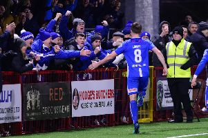 Stevie Lowry celebrates in front of the Coleraine supporters following his goal in the Irish Cup success over Larne. Pic by Pacemaker.