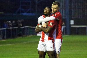 Brackley Town's Lee Ndlovu celebrates his second goal with Shane Byrne against Nuneaton Borough at St James Park. Photo: Steve Prouse