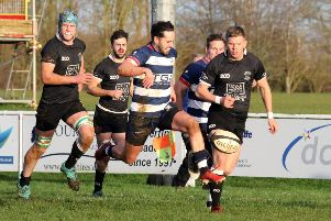 Joe Mills kicks the ball down the touchline to set up Tommy Gray's try for Banbury Bulls against Wimborne. Photo: Steve Prouse