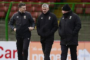 Gary Smyth (centre) has taken charge of Glentoran following Ronnie McFall's (right) resignation
