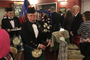 Piping in the haggis at Waltham Burns supper PHOTO: Supplied