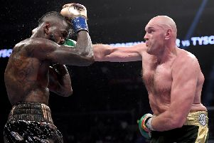 Tyson Fury punches Deontay Wilder (Photo by Harry How/Getty Images)