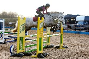 Sophie Cowan riding Temp Quickstep, clear in the 1m Showjumping