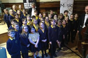 Upper Beeding pupils with conductor John Gibbons