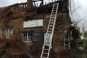 The Pickled Village was completely destroyed during Tuesday's fire NNL-190215-153727005