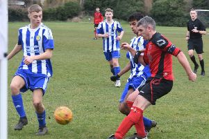 Mark Baines (red) in action for Netherton United at the weekend. Photo: David Lowndes.