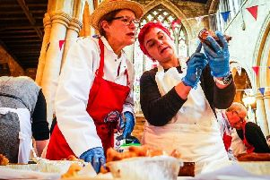 Judges check out an entry in the vegan pie class at the British Pie Awards in Melton this week EMN-190803-150632001