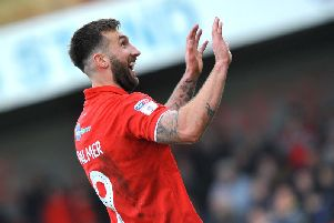 Ollie Palmer celebrates one of his two goals against Grimsby Town