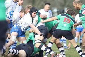 Lions skipper Conor Gracey gets stuck in against Preston Grasshoppers. Picture: Mick Sutterby